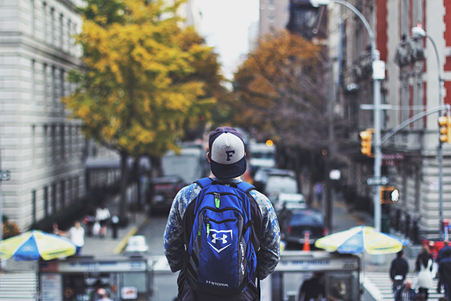 boy looking at view with his backpack