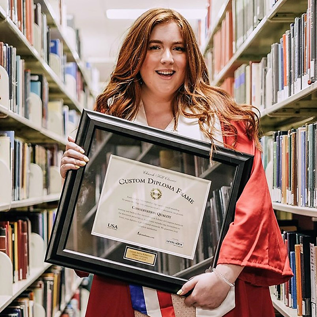 girl-holding-a-diploma-frame-engraved-nameplate