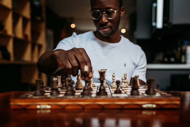 Guy playing chess