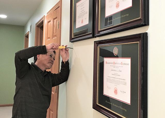 man hanging frames