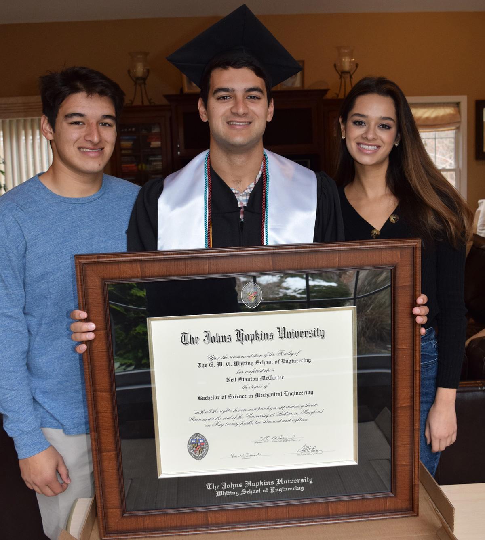 students-holding-framed-diploma