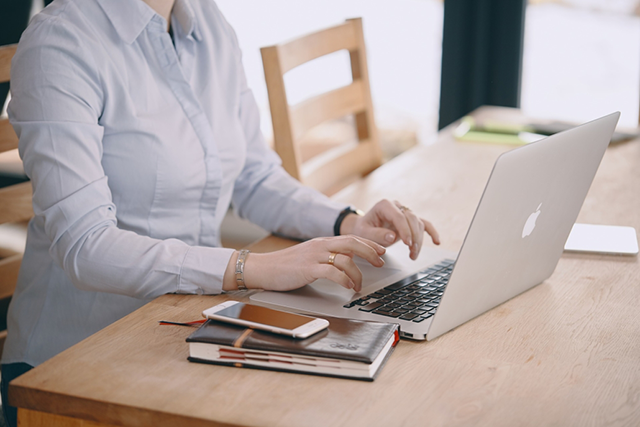 woman on computer at desk